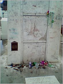 Scholars agree that this is the tomb of Marie Glapion Laveau. Note the trinkets left by visitors. (Source: Wikipedia: Marie Laveau)