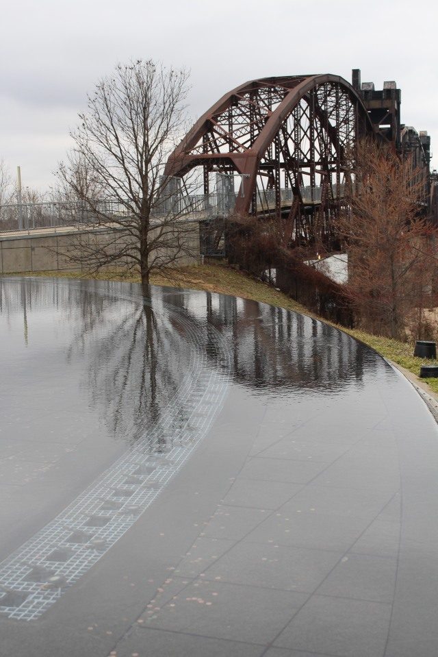 Reflecting pool and pedestrian bridge at Clinton Presidential Library