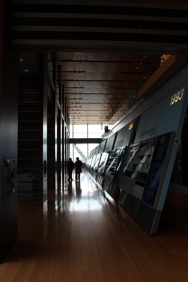 Timelines line up on the first floor housing artifacts focusing on themes of the Clinton administration.