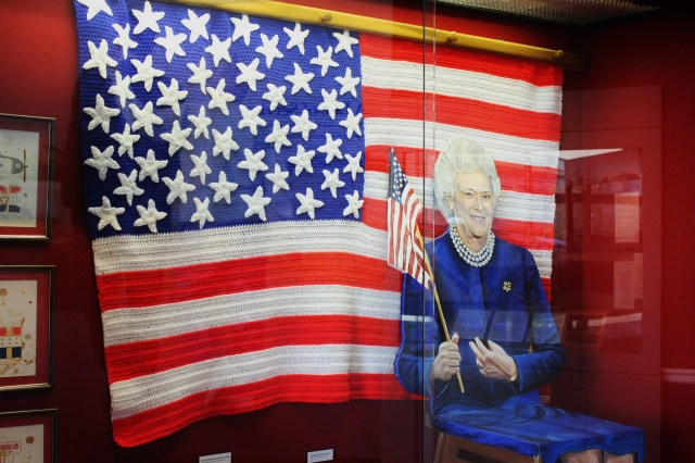 Barbara Bush with U. S. flag at Bush Presidential Library and Museum.