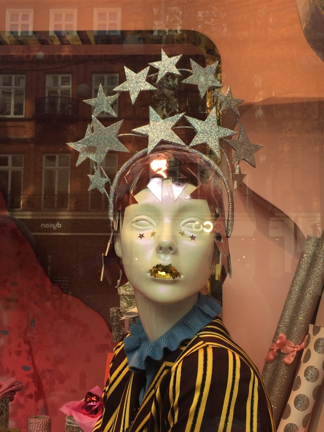 Glittery mouth and headpiece of stars -- this fashionable young lady played a starring role in the windows at Selfridges!
