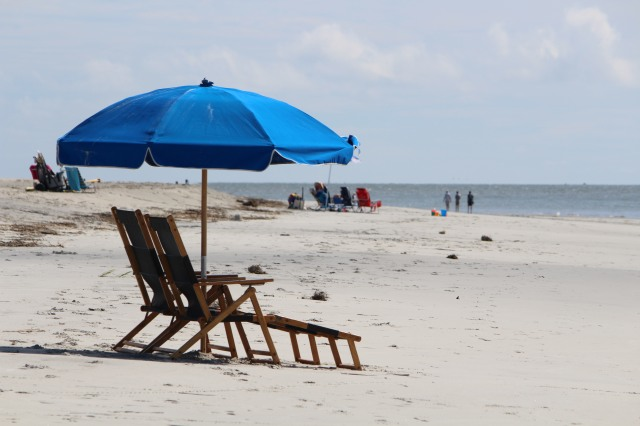 What could be better than a day at the beach under a blue umbrella?