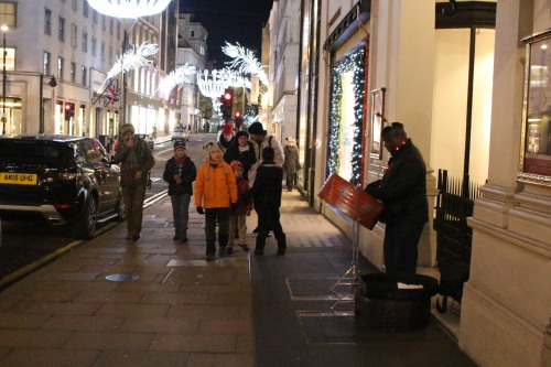 A lone street musician added sounds of the season to our window shopping excursion on Bond Street.