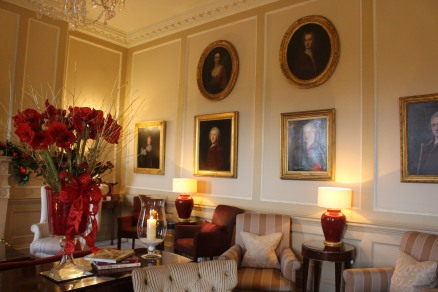Portraits, period furniture, and subtle fabrics ensure a tasteful overall appearance at The Royal Crescent in Bath.
