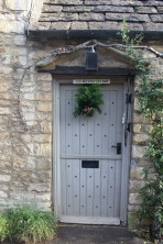 Pale blue door with wreath -- ready for Christmas.