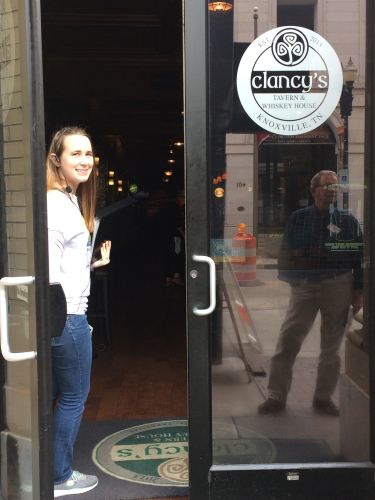Tour guide Lauren Quinn holds the door open for Bert Sams at Clancy's Tavern