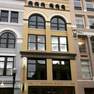 Beautifully renovated building that holds Maple Hall with residences above.