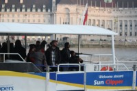 Passengers on a SunClipper, cruising the Thames