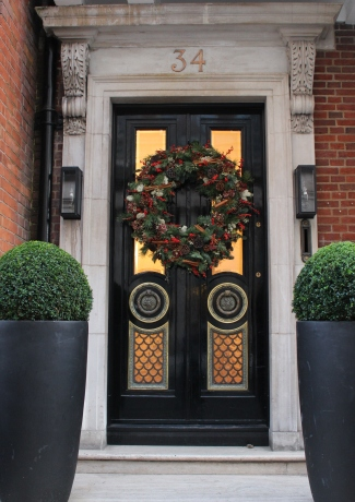 Glass paneled door decorated for Christmas