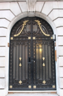 Touches of gold with black: London door