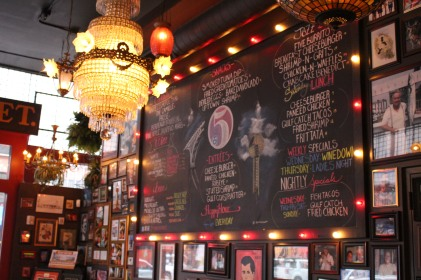 Chalkboard menu and memorabilia at the entrance greet guests at FIVE Knoxville