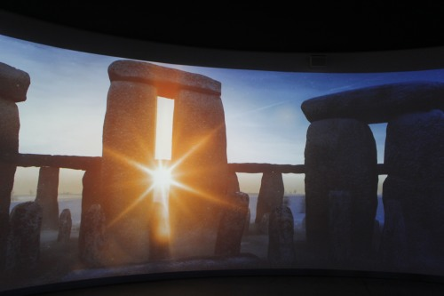Sun coming through an opening at Stonehenge, from a video at the Visitor Center.