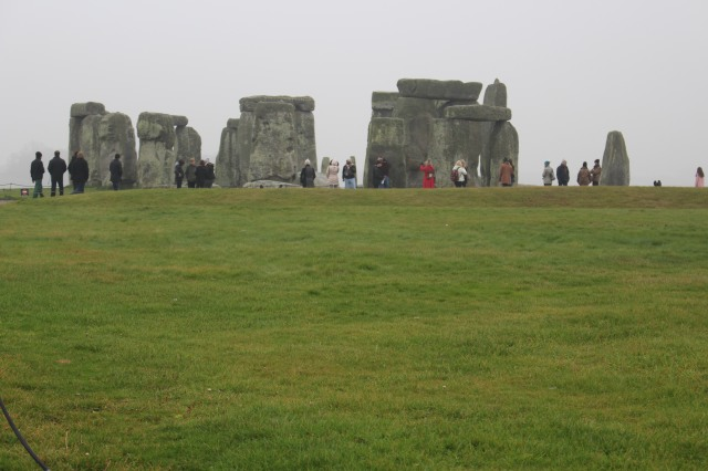 Crowds stand in awe around the formation known as Stonehenge.
