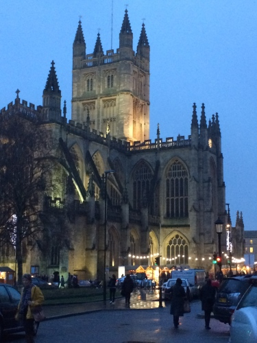 Bath Abbey at Christmas with market shops below