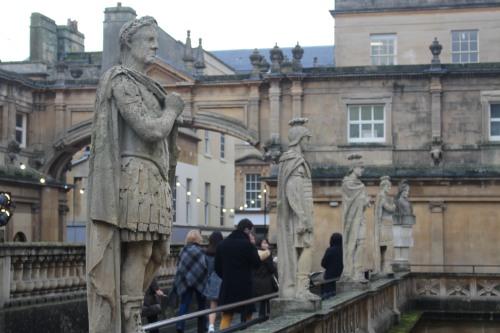 Visitors on the terrace of Roman Baths, Bath, England