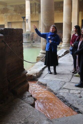 Tour guide shares information on the water of the Roman Baths