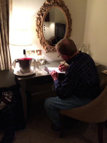 Bert found time to write a postcard and sip some wine in our room at Lords of the Manor.