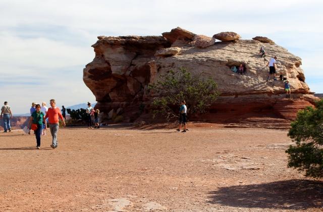 Climbing the rocks at Canyonlands