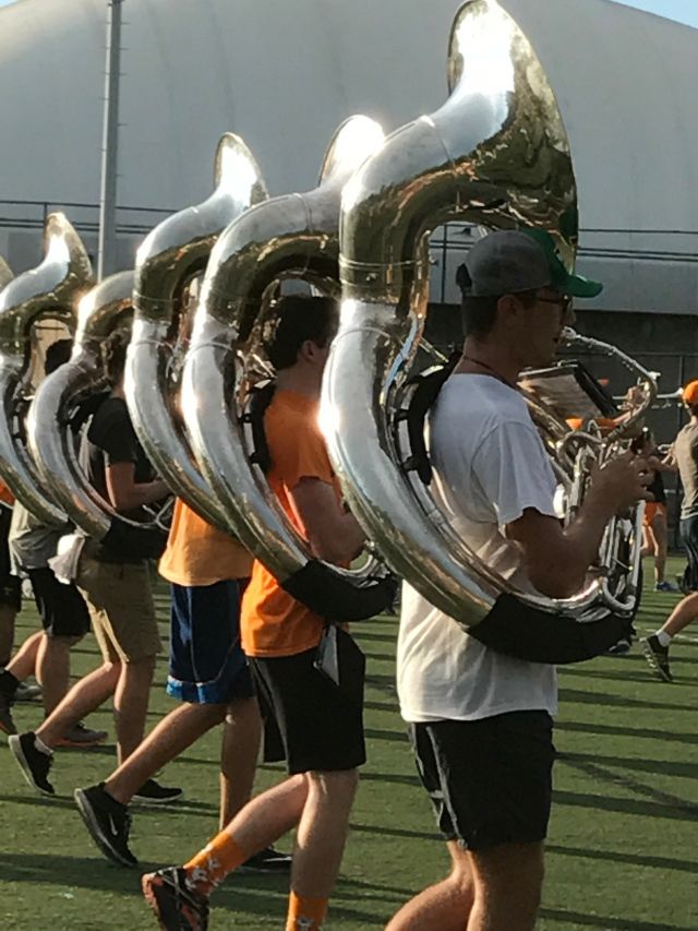 """Looking shiny even on the practice field, the Pride of the Southland tubas pump out """"Rocky Top."""""""
