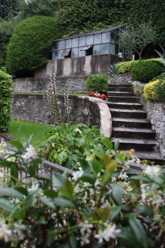 Pretty as a picture:  a backyard greenhouse and stone steps in Varenna.