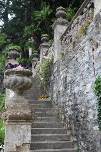 Concrete urns lining a walkway at Villa Monastero