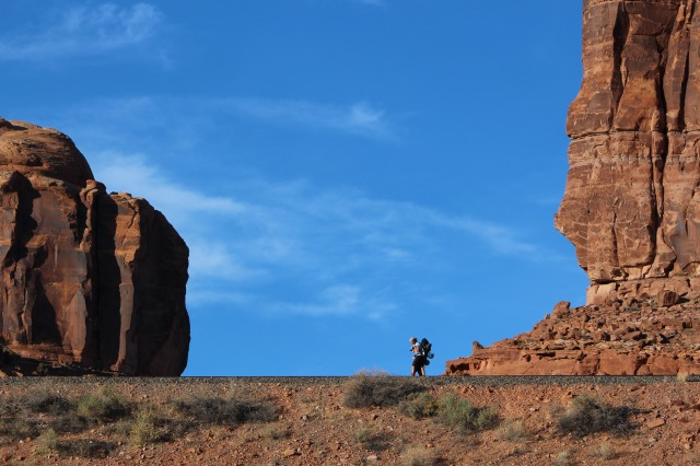 Lone hiker makes his way along Potash Road.