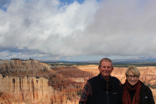 With the wind and rock at our backs, enjoying Bryce Canyon!