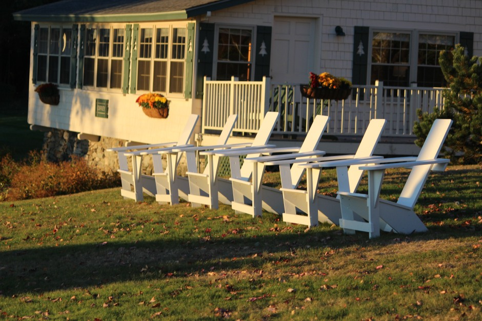 Afternoon glow on a line of chairs at Spruce Point Inn, Boothbay Harbor.