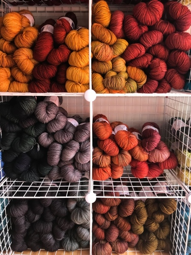 Colorful bins of hand-dyed yarn waiting to be touched and bought!