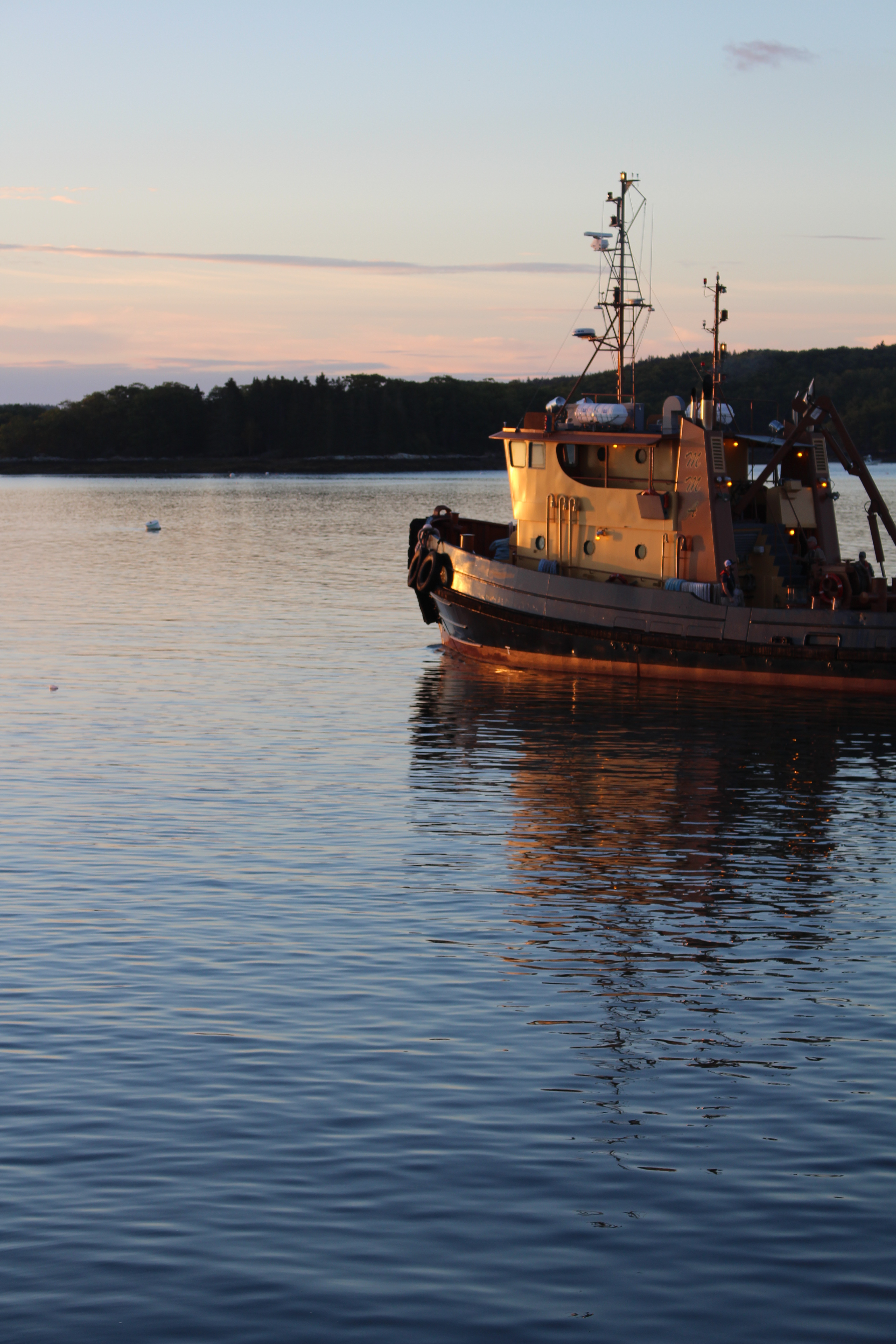 Facing the day, awash in morning light: the Maine Maritime Academy teaching boat in Castine harbor