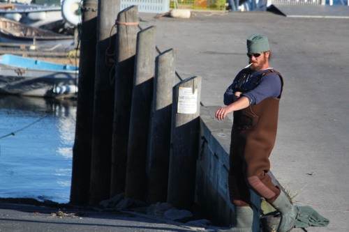 Dressing to bring 'em in: Maine lobsterman prepares for work.