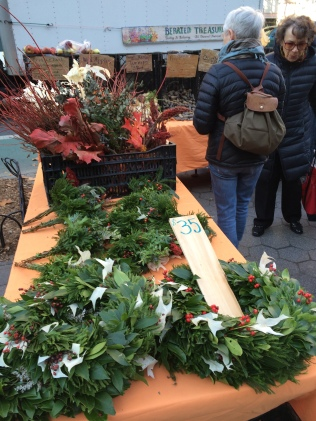Christmas wreaths at NYC sidewalk stand