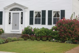 Classic shutters and decorative door: Castine, Maine