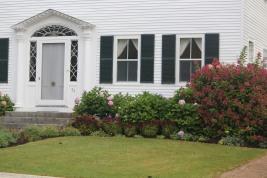 Classic shutters and decorative door: Castine, Maine