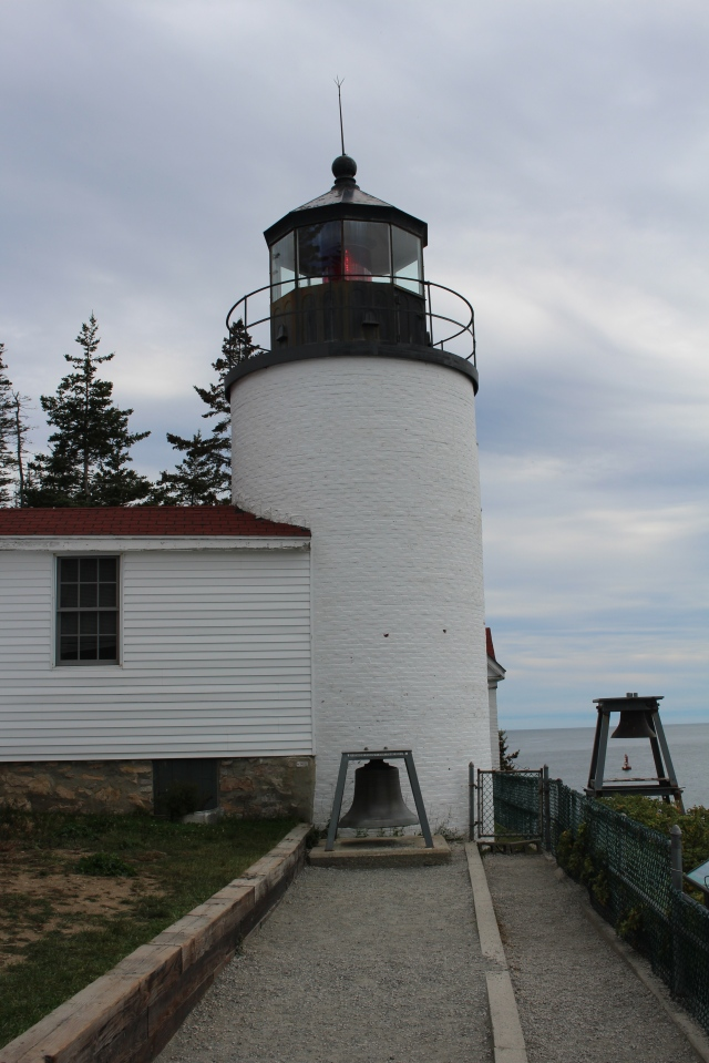 View from the right:  Bass Harbor Light with original bell in foreground.