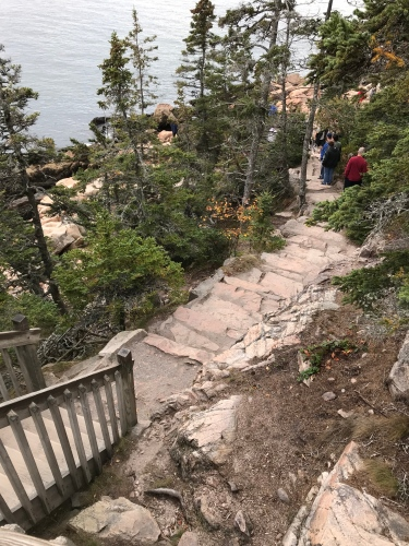 It's a long climb down the steps to view the Bass Harbor Light above.