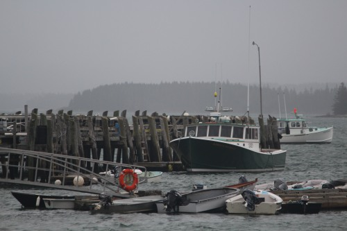 Gray scene with life preserver:  Stonington harbor.