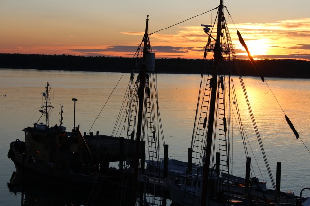 Early morning sun brightens the waters of Castine harbor where the sailing vessel Bowdoin resides.