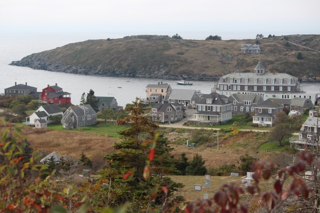From lighthouse hill: a view of the town of Monhegan. Dominating the landscape: The Island Inn. But also noticeable -- the red house among the grays.