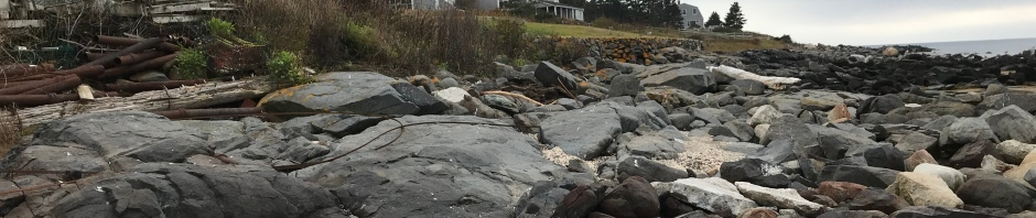 With a rocky shore for a side yard, this house faces the elements on the island of Monhegan.