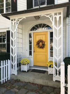 Yellow entryway for a white house on Water Street, Castine