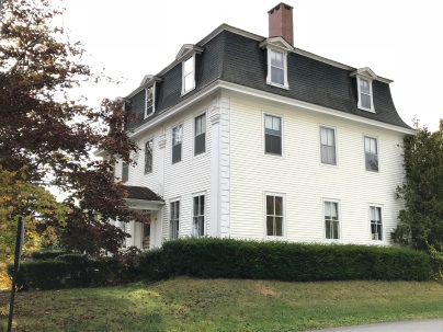 Mansard roof on this stately white home in Castine
