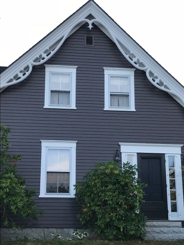 Gray cottage with black door
