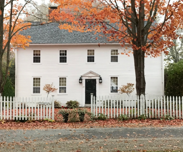 A Pinterest favorite is this home surrounded by trees of autumn splendor standing in the square of Castine.
