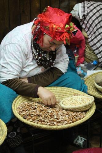 Shelling argan nuts in the Marrakech medina.