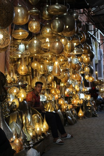 A stall filled with pierced metal lighting in the Marrakech medina.