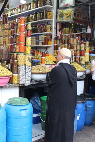 Shopping for preserved goods and spices in open bowls: Marrakech medina