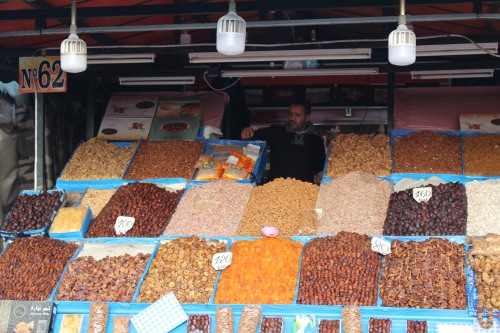Looking like a patchwork quilt, rows of nuts and dates wait for customers.