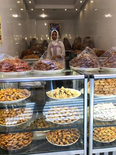 Bowls and platters hold sweets for Ramadan in this medina stall in Marrakech.