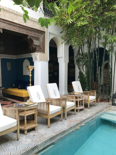 Alcoves and lounge chairs offer luxurious relaxation at Riad Les Yeux Bleus.